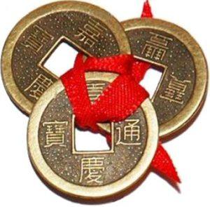 Три монеты счастья на красной ленте...